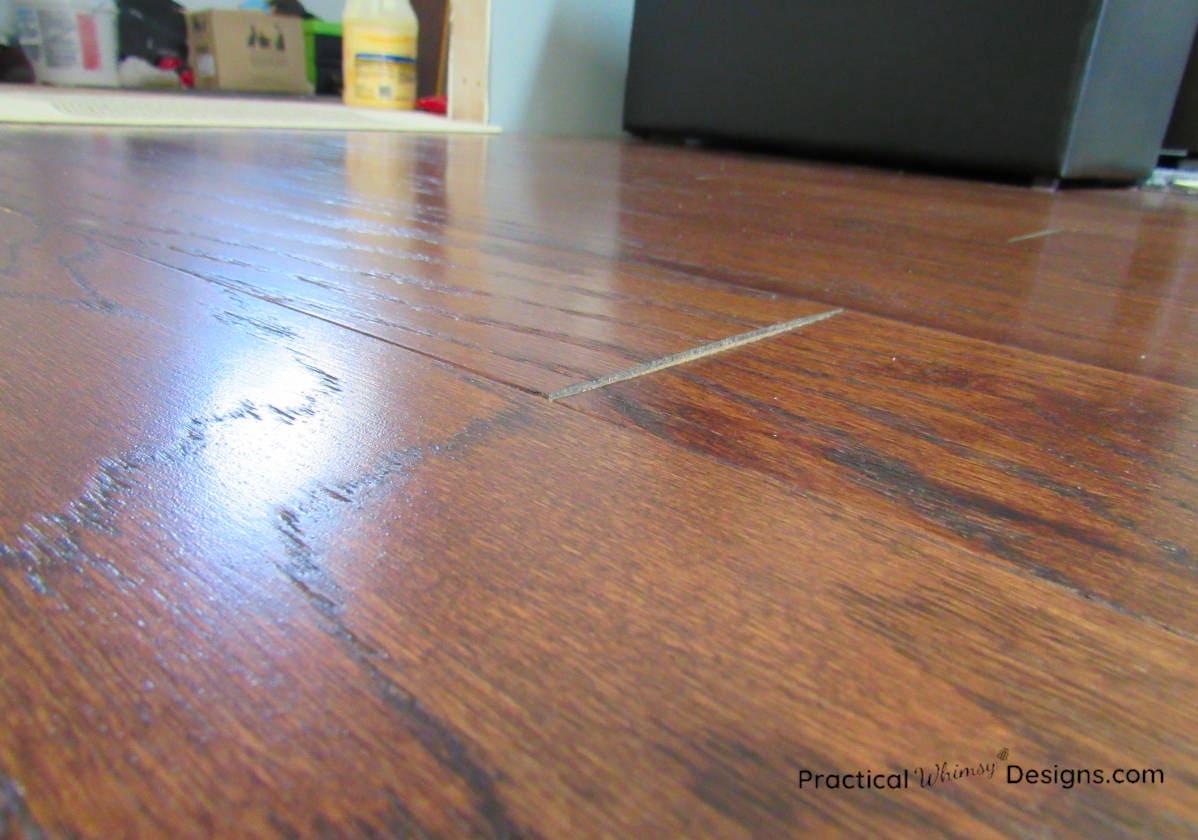 Engineered hardwood floor board warping at the edge