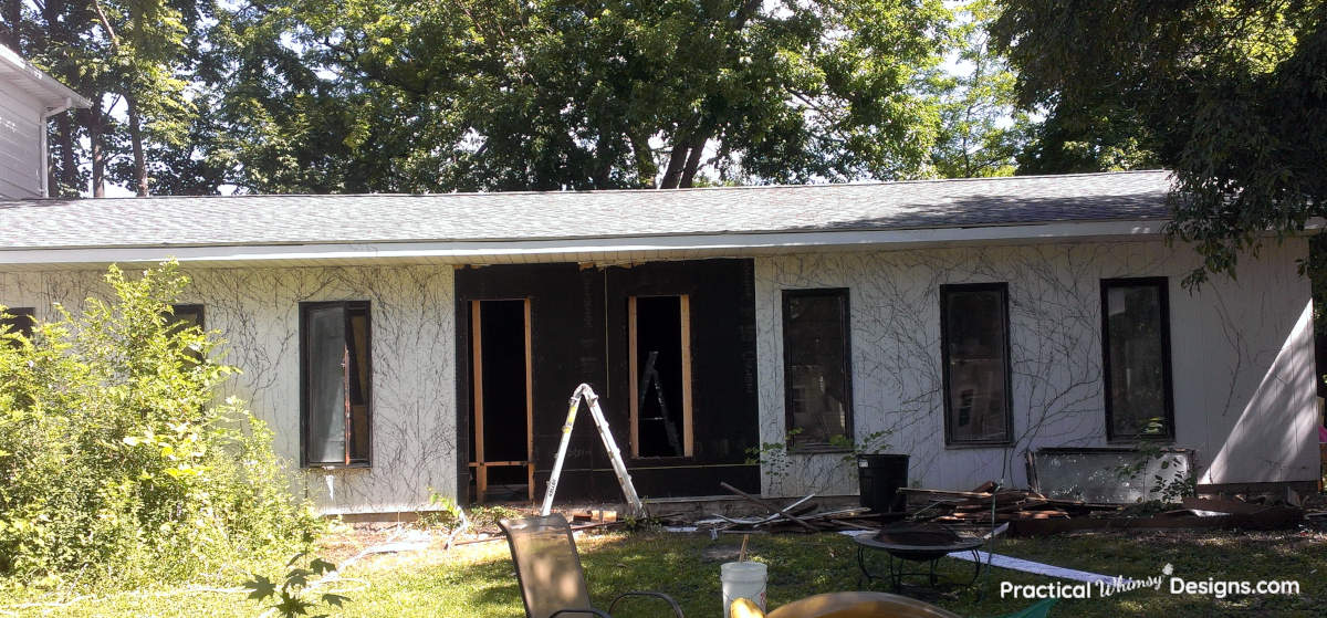 Paneling removed from rundown pool house