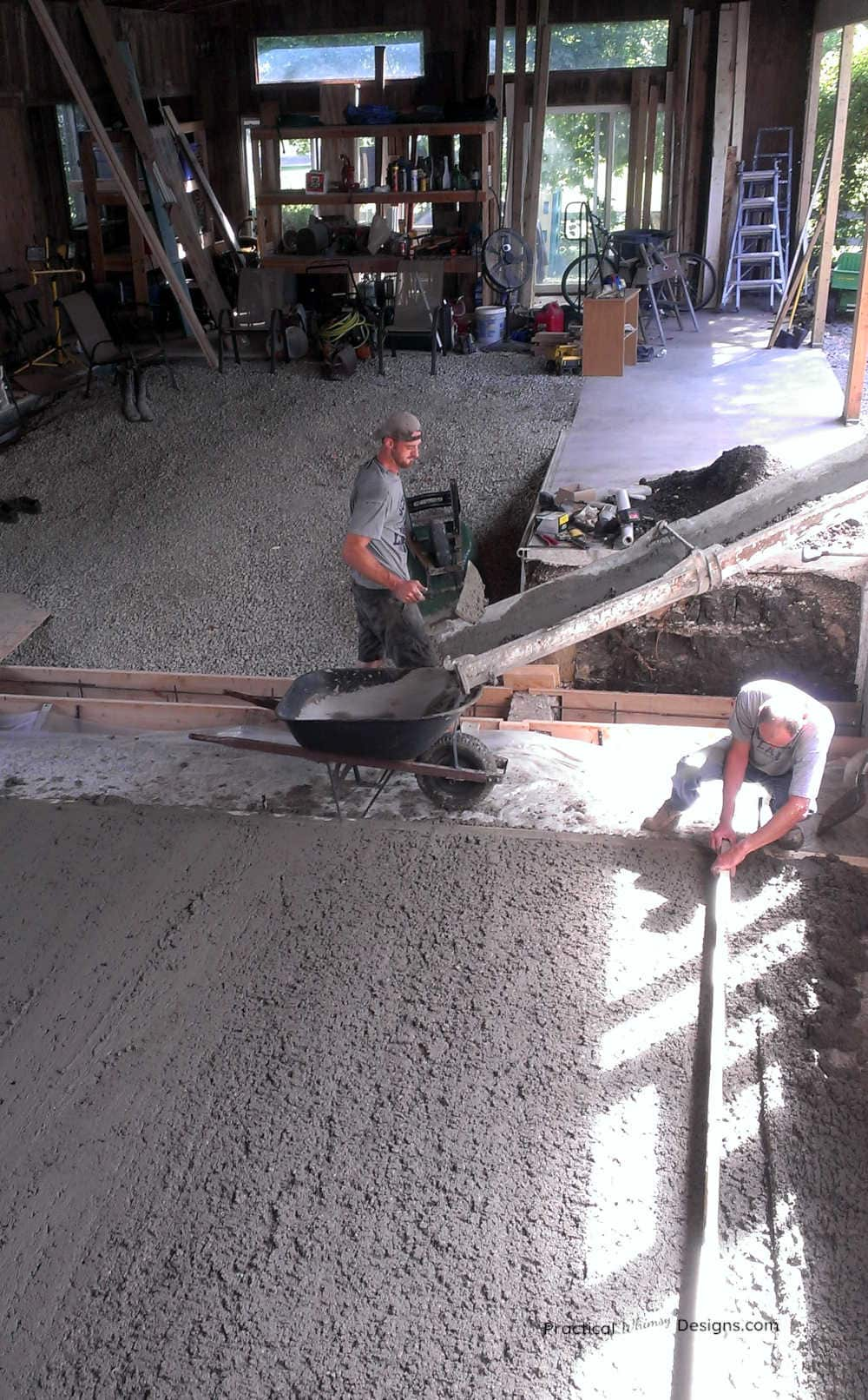 Pouring concrete in old pool