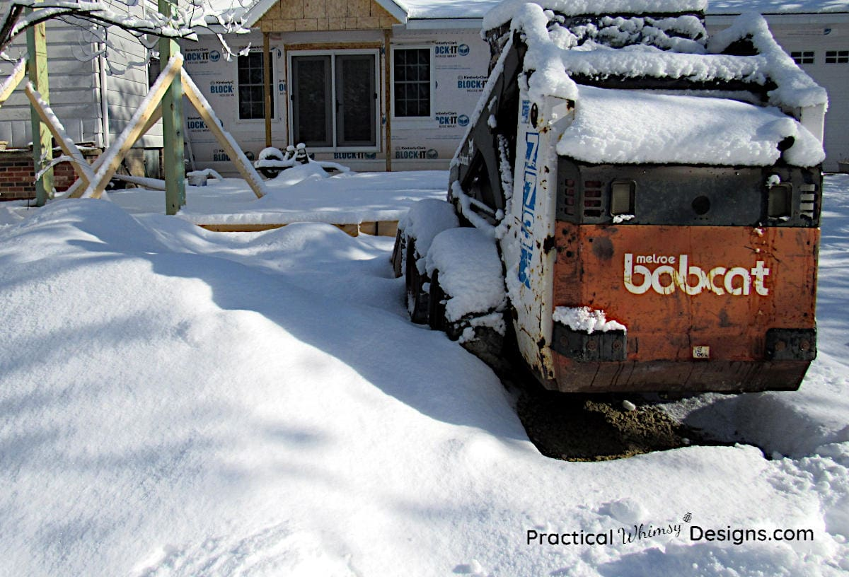 Bobcat excavator covered with snow