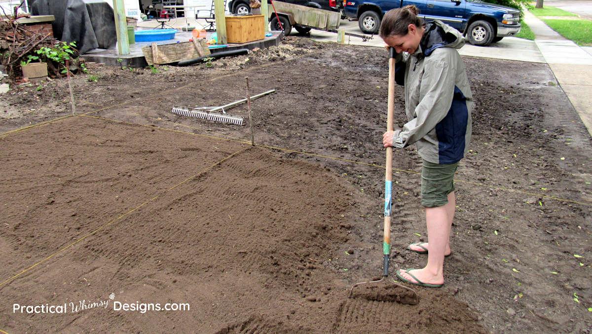 Raking dirt for grass seed planting