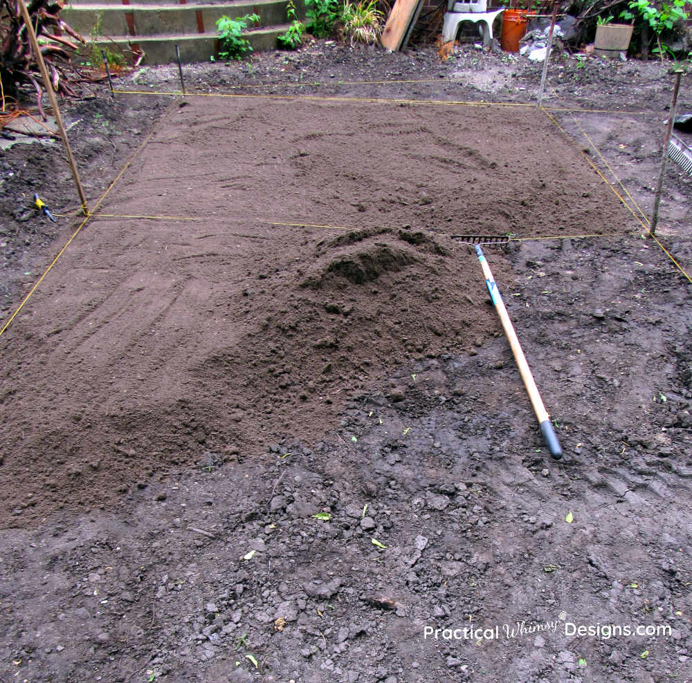 Spreading topsoil for new grass seed