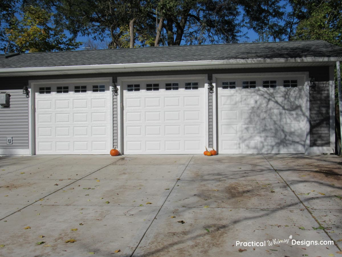 Grey and white garage with pumpkins