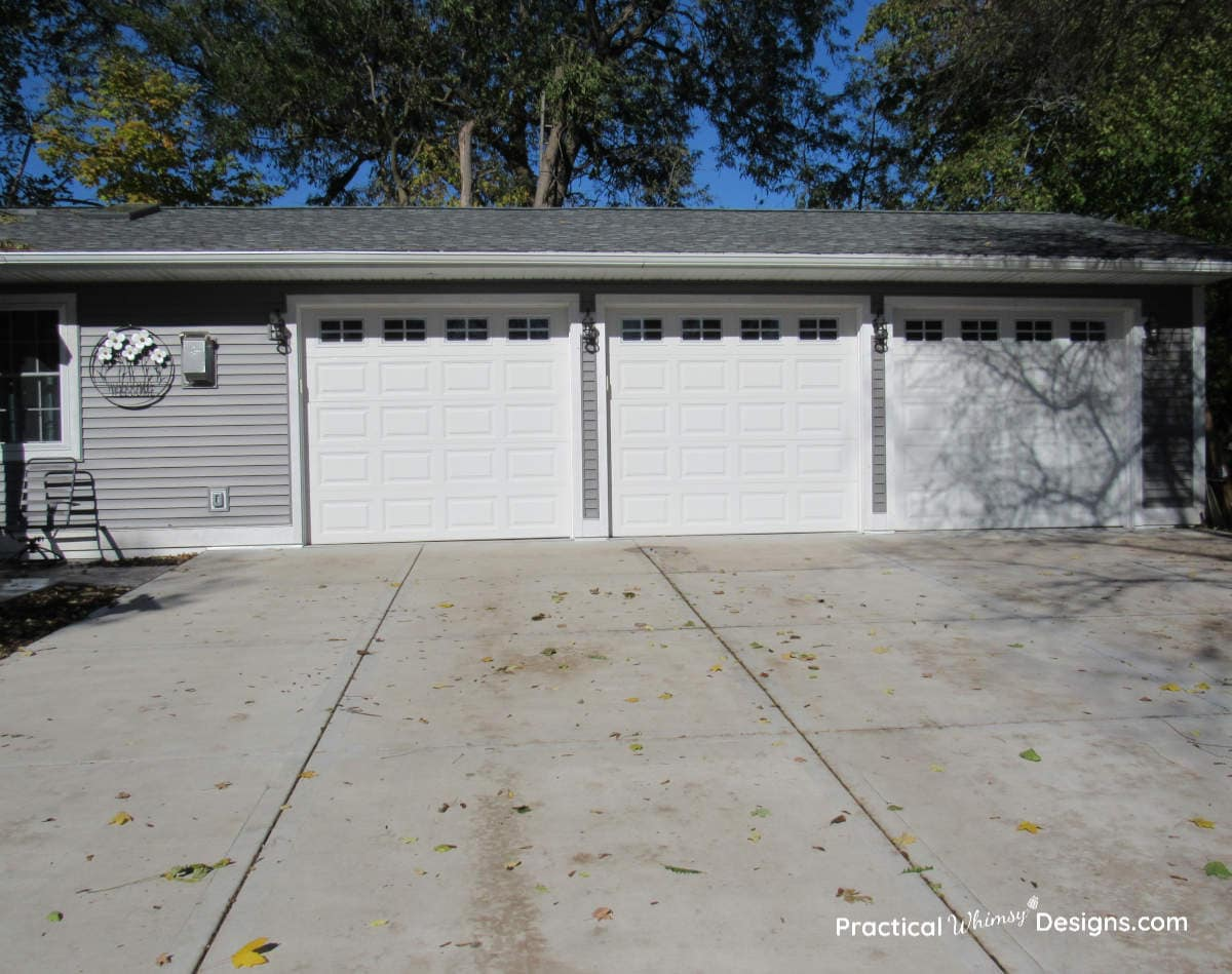 Three car garage with white garage doors