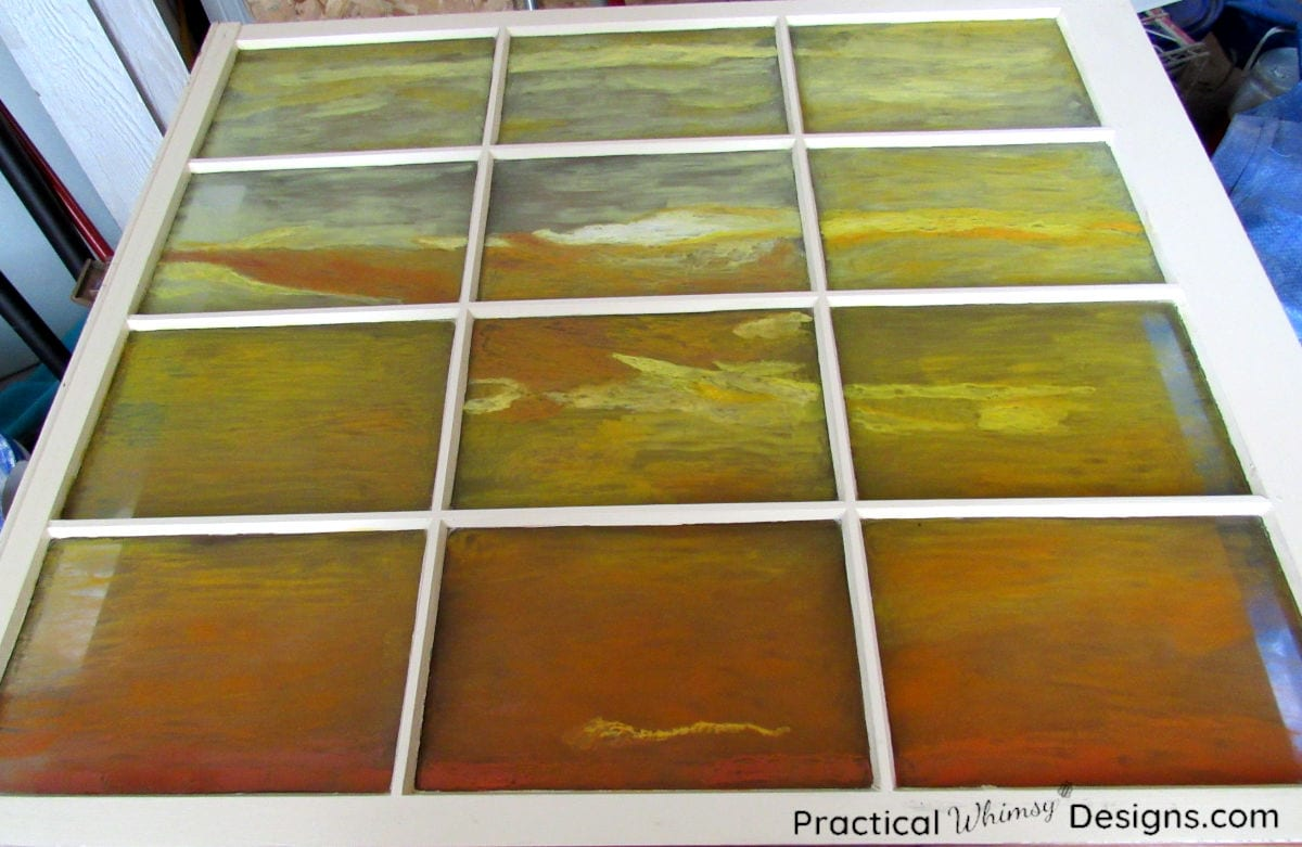 Sunrise painted on glass window