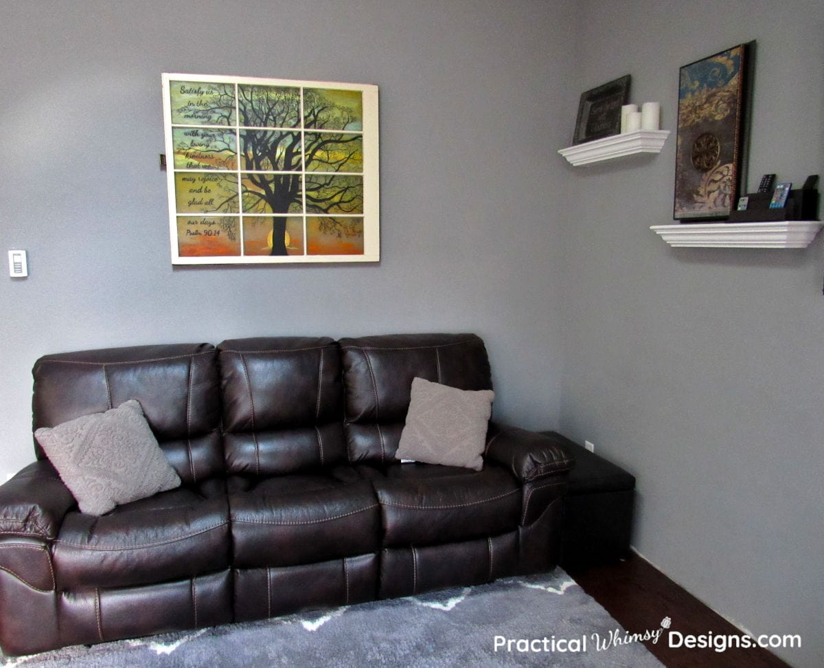 Stained glass window painting over couch