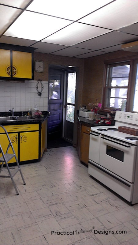 Kitchen with lemon yellow cabinets and stove