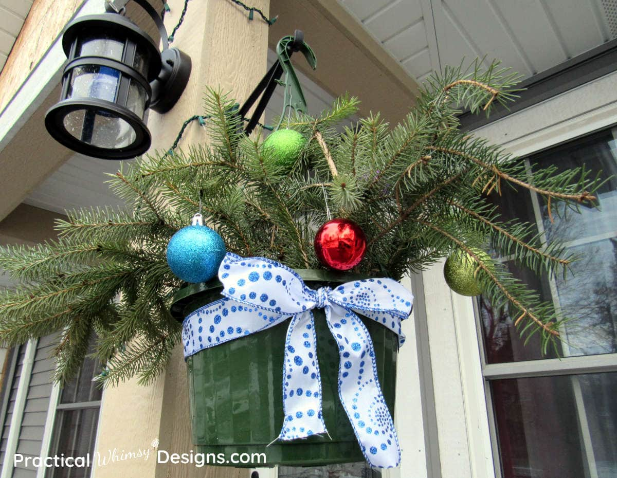Hanging basket with Christmas ornaments and ribbon