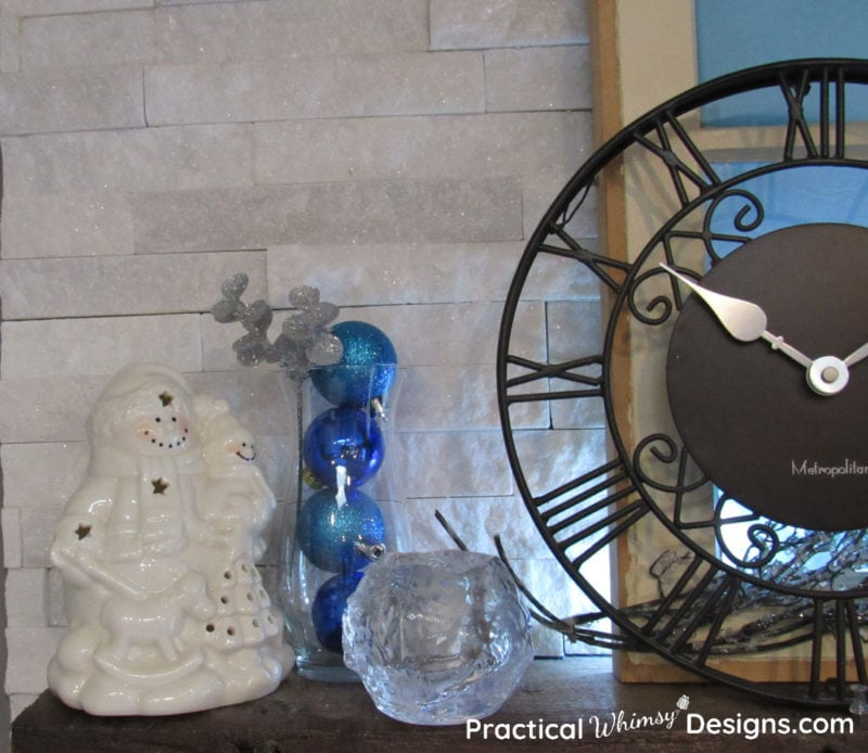 Blue ornaments in vase with snowman
