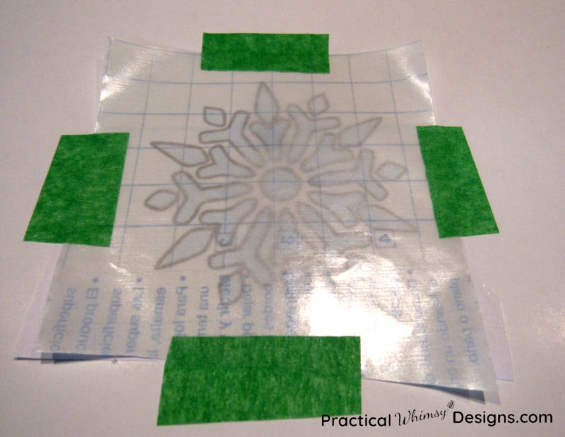 Taping snowflake decal