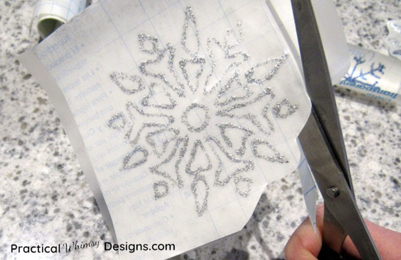 Cutting out snowflake window decal