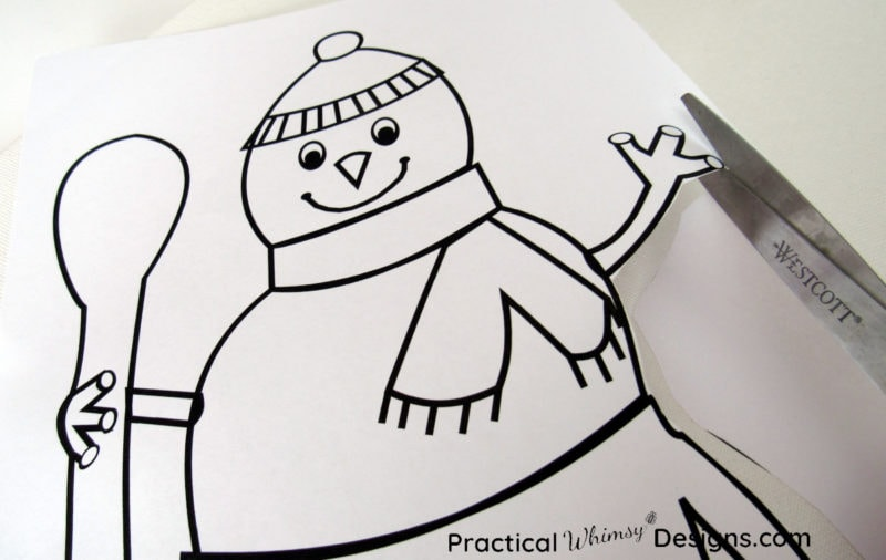 Cutting out snowman template for lighted canvas pictures