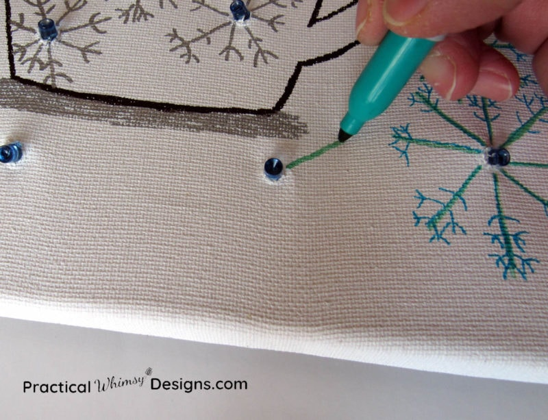 Drawing snowflakes on lighted canvas