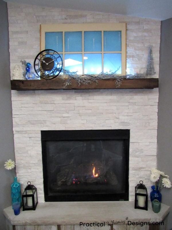 Flowers and winter decorations by fireplace