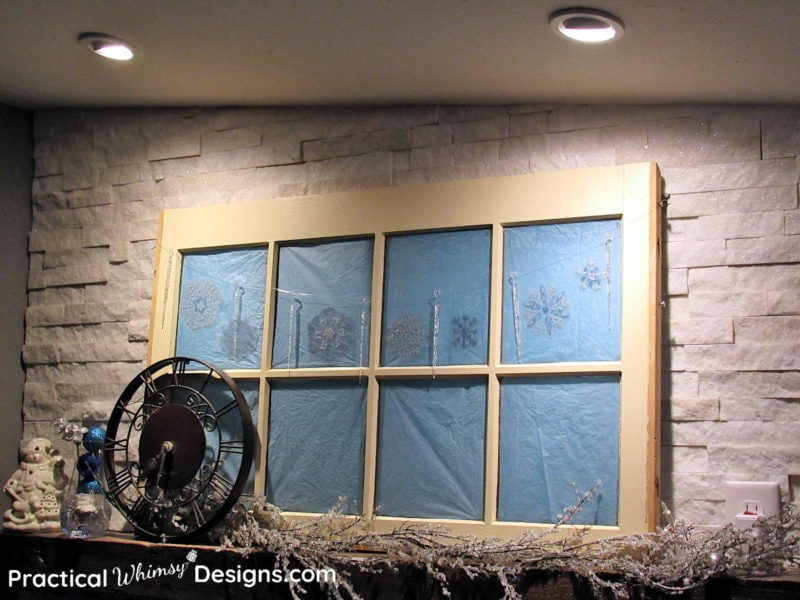 Snowflake window decals on mantel window