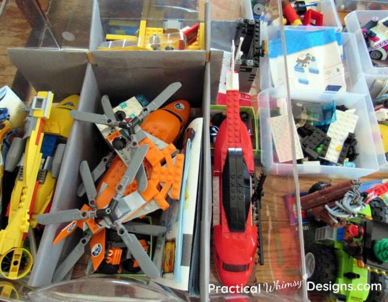 Lego kits organized in drawer