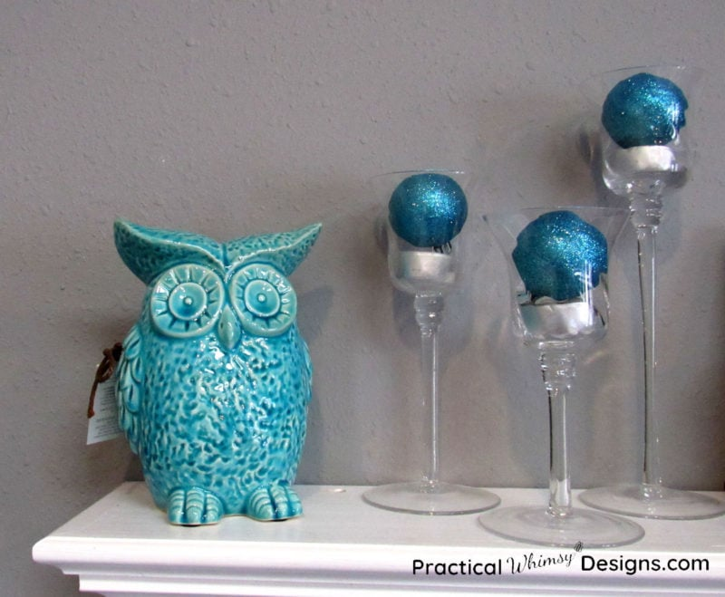Teal owl figurine with blue candlesticks
