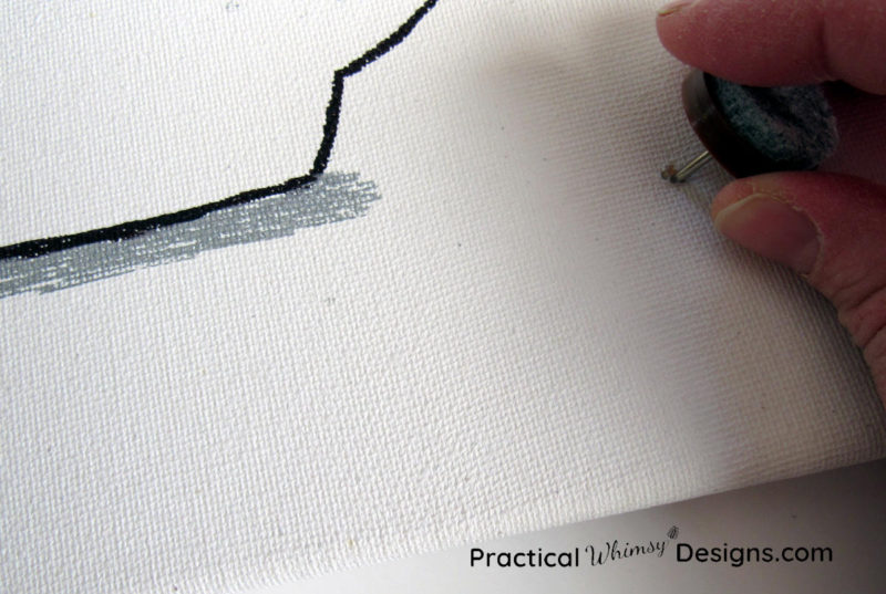 Poking holes in the canvas to insert lights