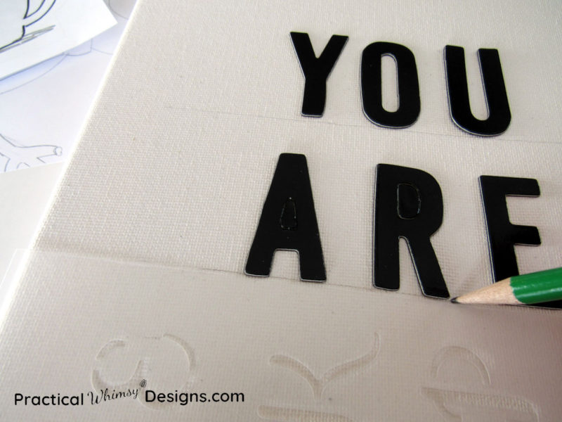 Tracing letter onto canvas pictures