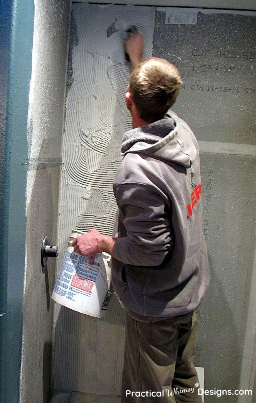 Applying mortar to shower wall for tile