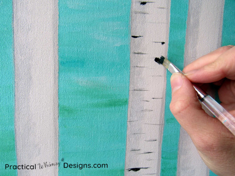 Painting birch tree knots on birch tree painting