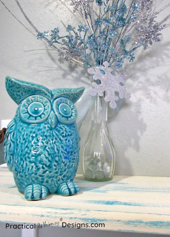 Owl and vase on distressed painted shelf