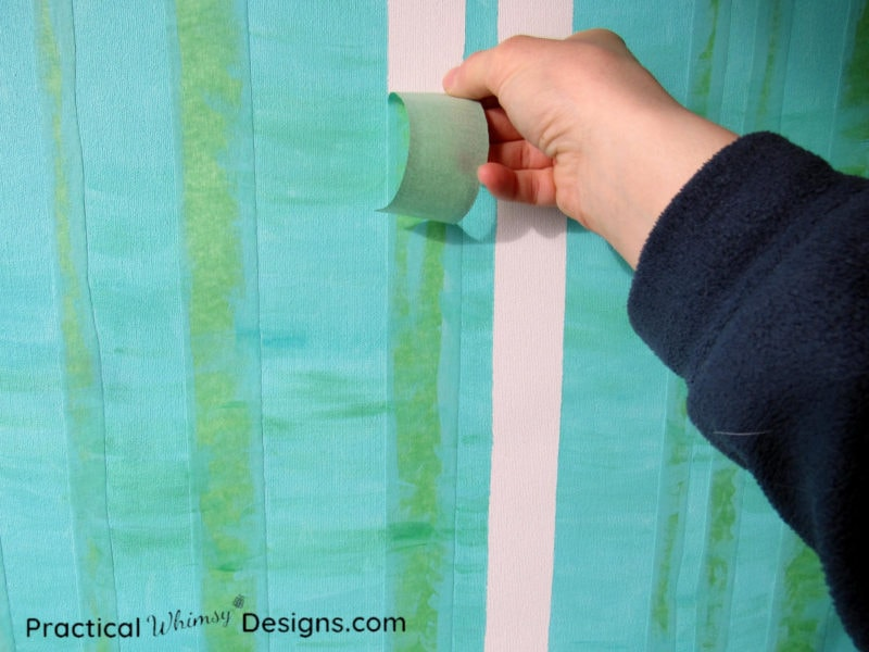 Pulling tape off of canvas