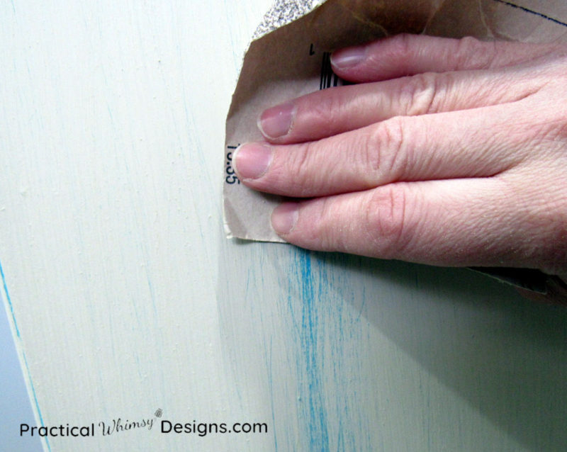 Sanding top paint layer of distress painted furniture