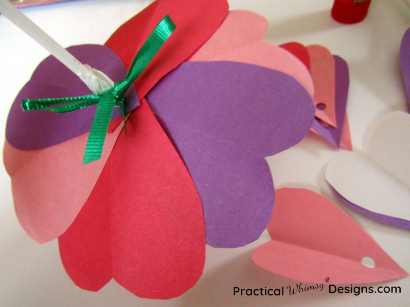 Tying ribbons on valentines card flowers
