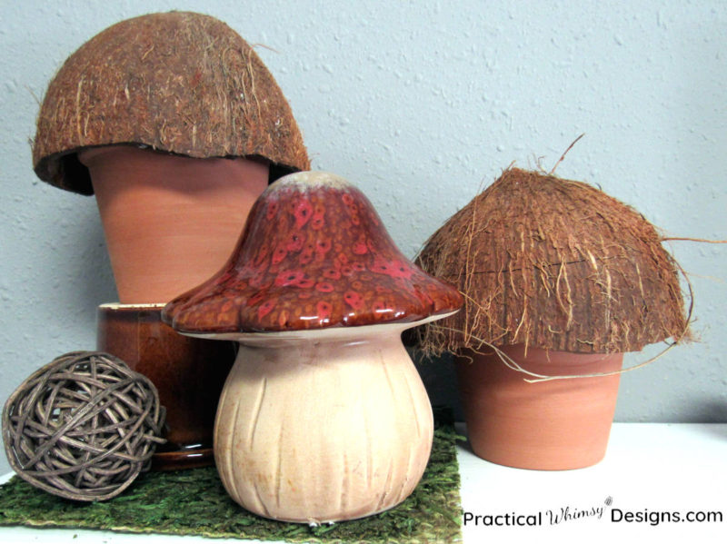 Three mushroom decorations on shelf