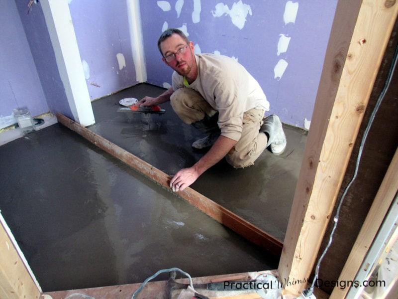 Putting leveler onto the Master Bathroom floor