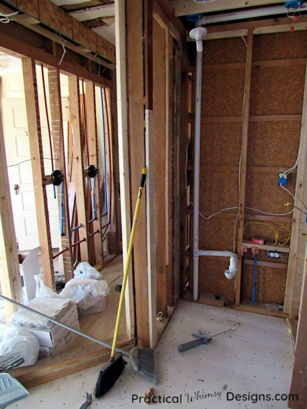 Master bathroom torn down to the studs