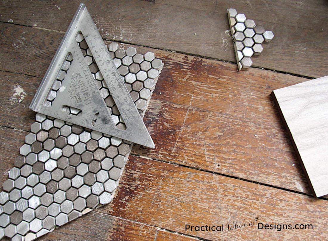 Measuring tile on wood floor for Master Bathroom ORC week 4 renovation