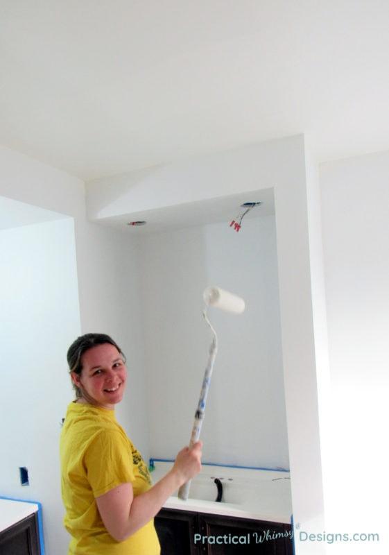 Paint rolling ceiling in Master Bathroom ORC week 4 renovation
