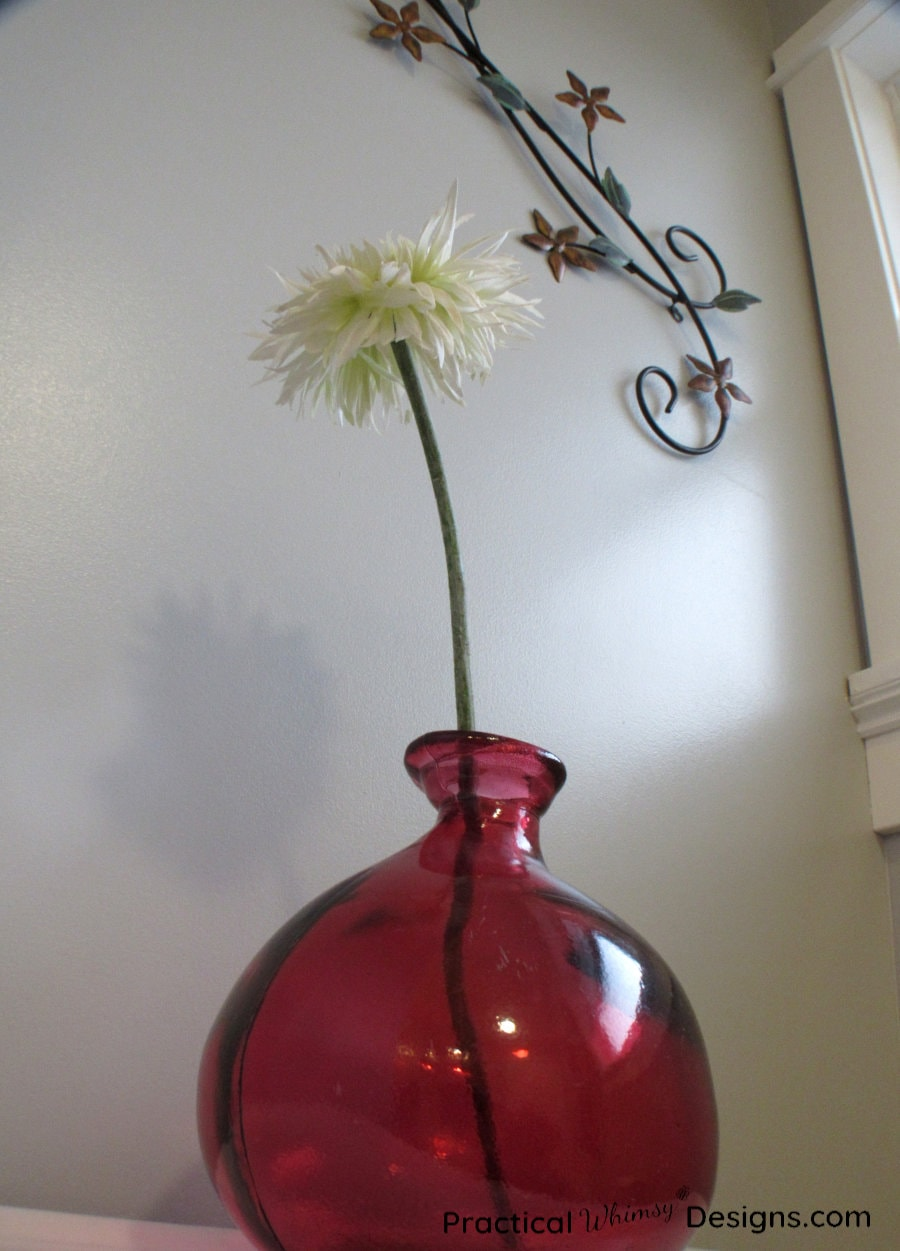 Red vase and white flower