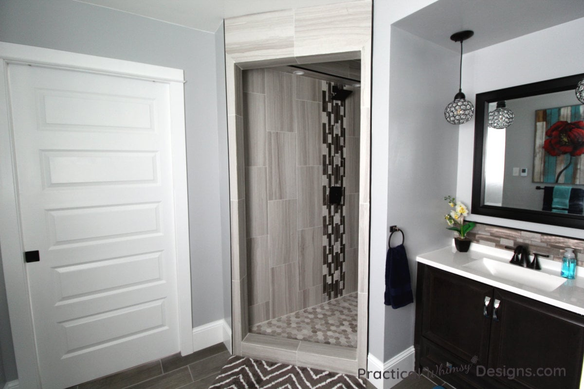 Shower, door and sink in master bathroom