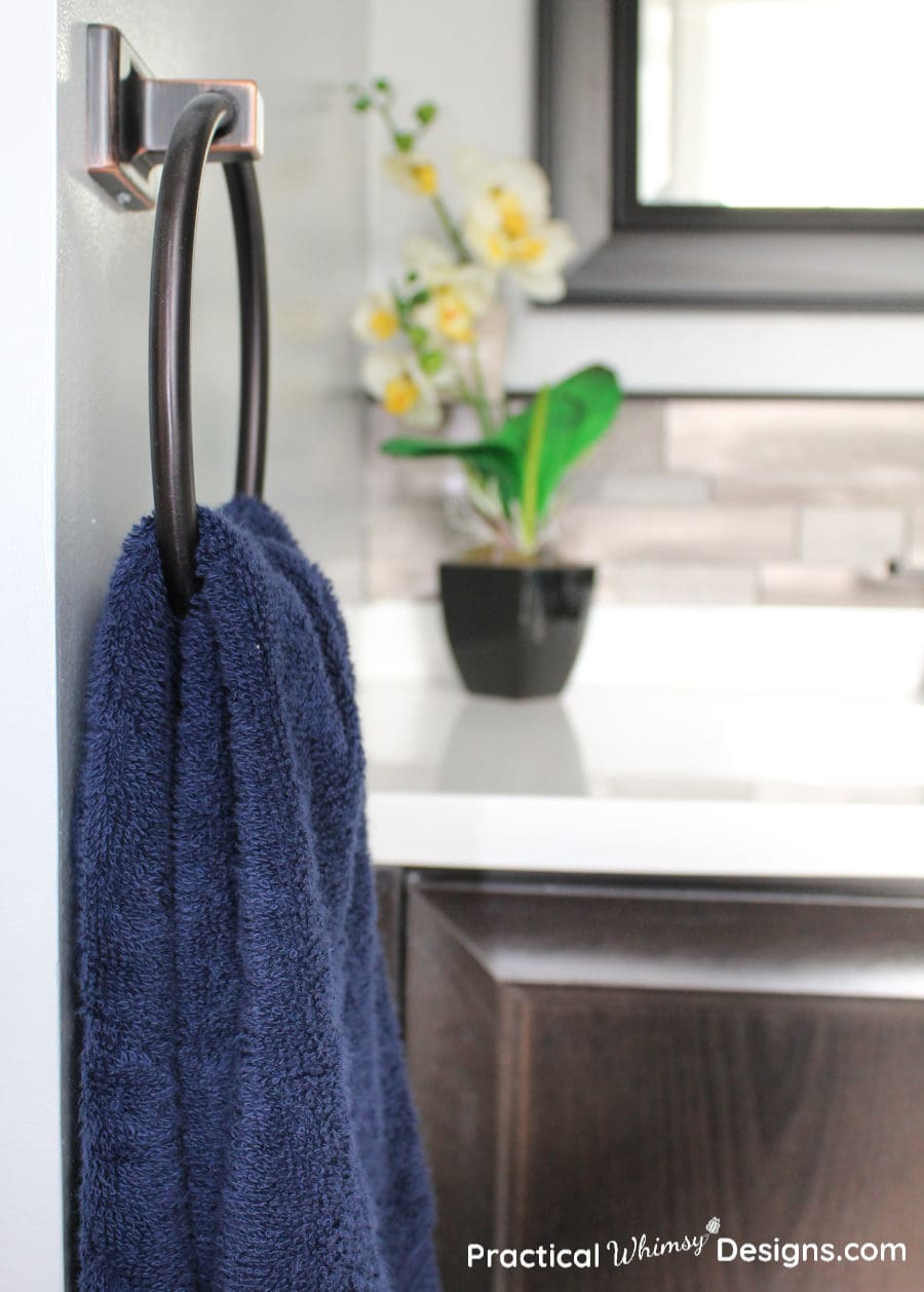Navy blue hand towel and flower