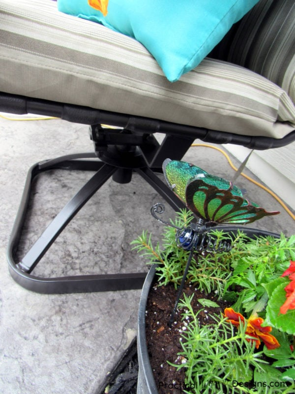 Flowers by refinished patio furniture