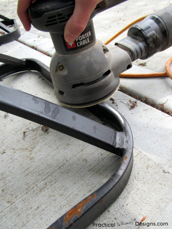Sanding chair base with sander