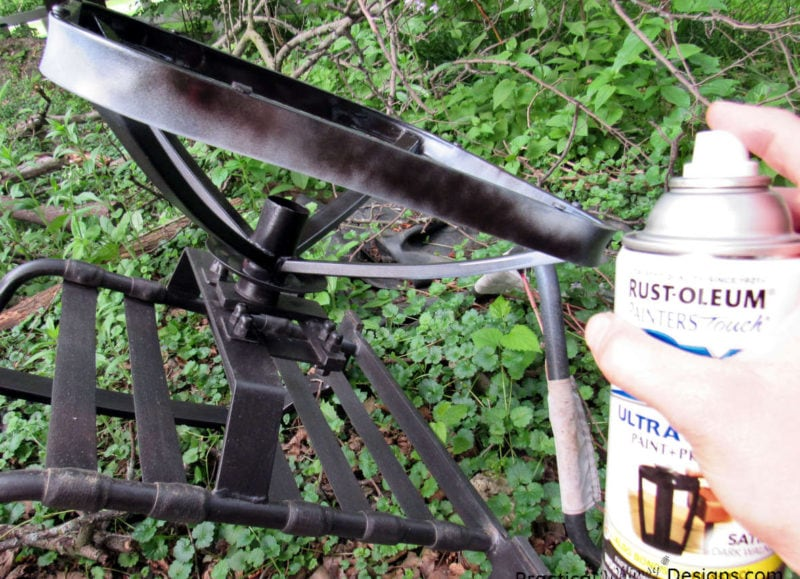 Spraying paint to refinish metal patio furniture