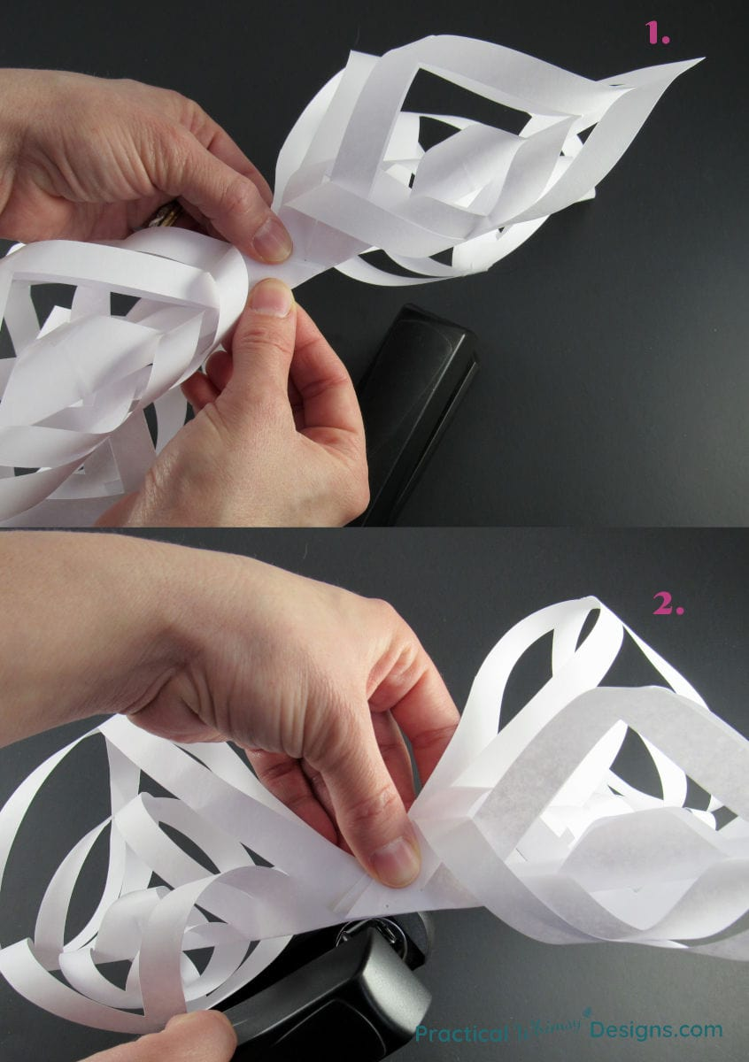 Stapling more pieces of the star together.