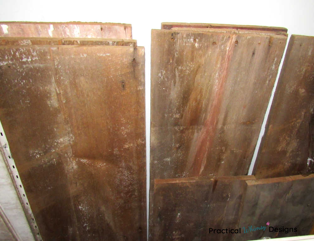 Wooden Barn Boards Leaning on the wall.