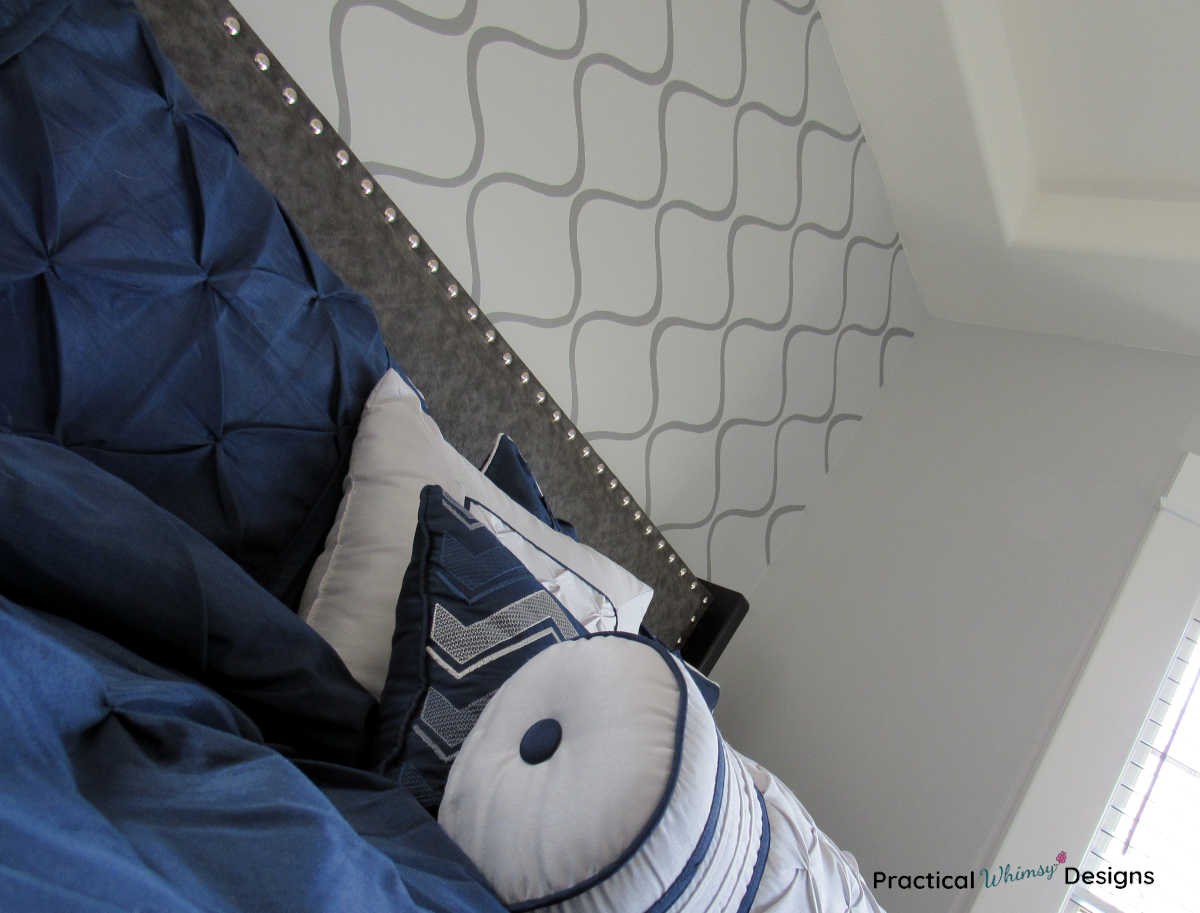 DIY Fabric headboard with blue comforter and pillows
