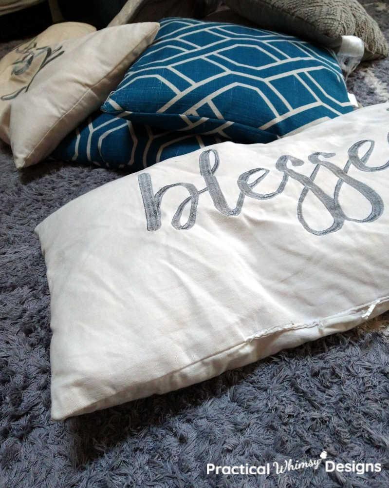 Flat white pillows before washing.