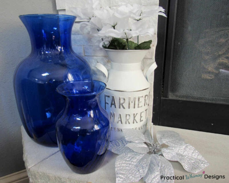 Blue vases and white jug on hearth