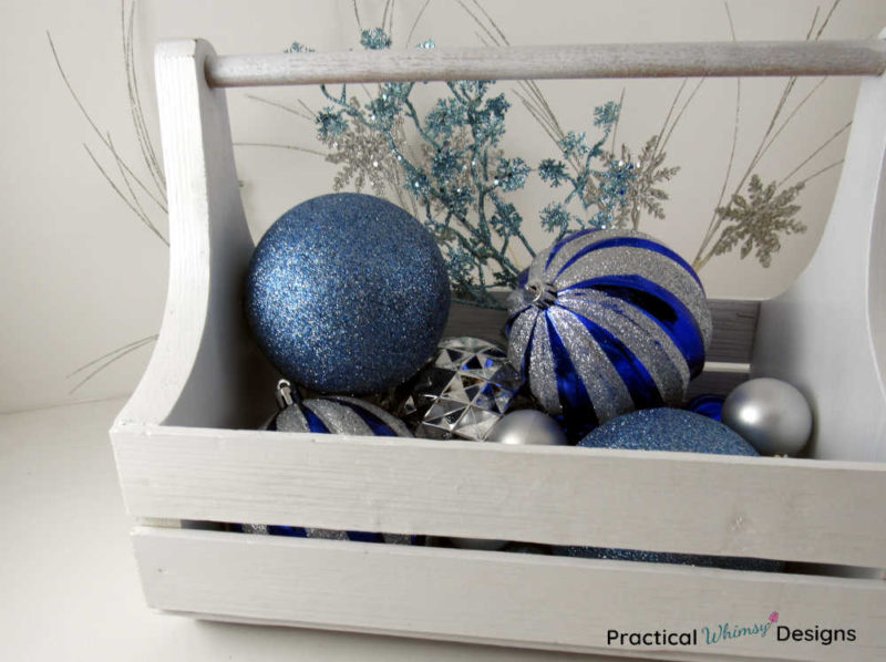 Caddy with blue and silver Christmas bulbs