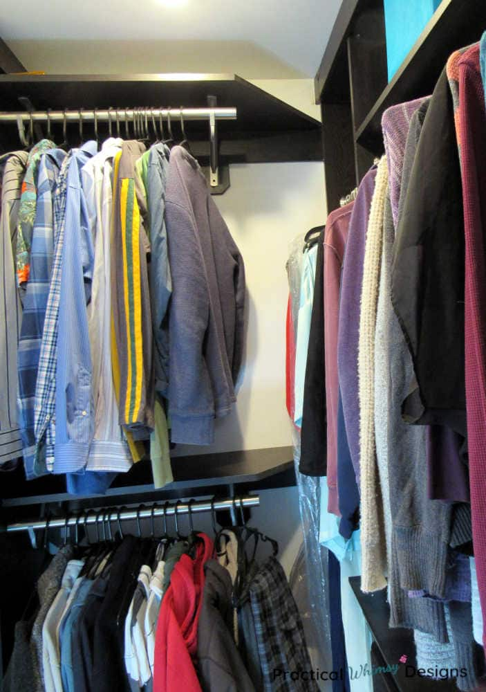 Clothes hanging in master closet