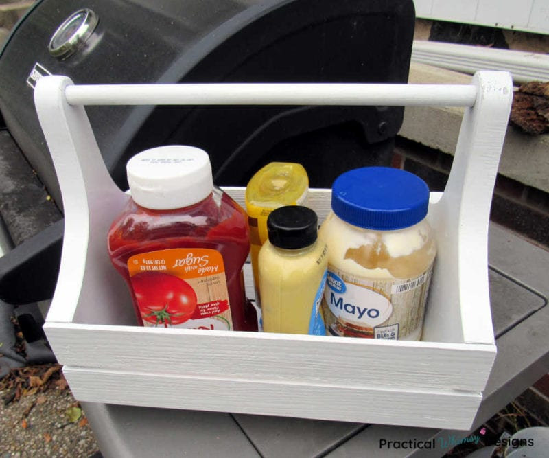 Condiments sitting on a grill