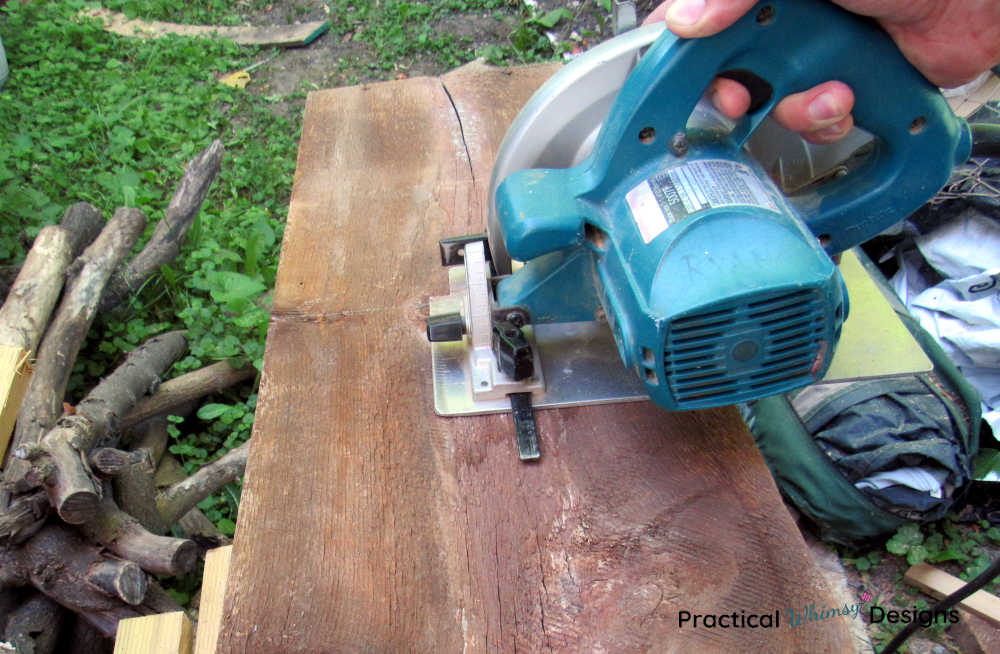 Cutting two foot boards with a circular saw.