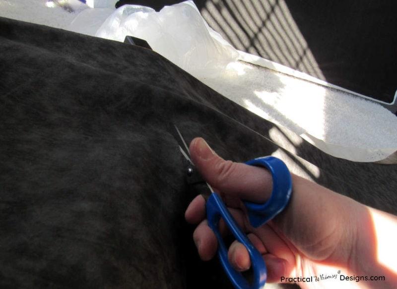 Cutting extra fabric off DIY fabric headboard